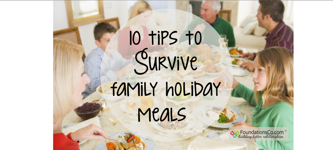 survive family holiday meals. Family enjoying dinner